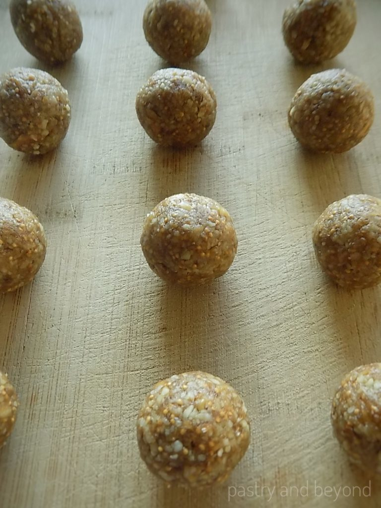 Steps of Making Healthy Fig and Walnut Balls: Rolling the paste into balls