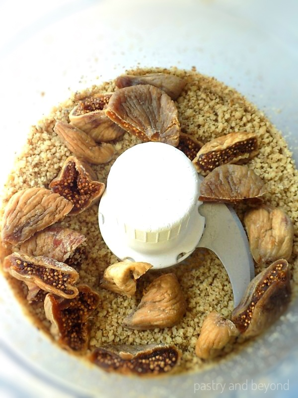 Ground walnuts and chopped dried figs in a food processor