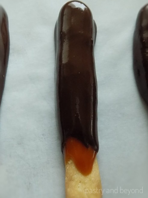 Caramel and Chocolate Sticks on parchment paper.