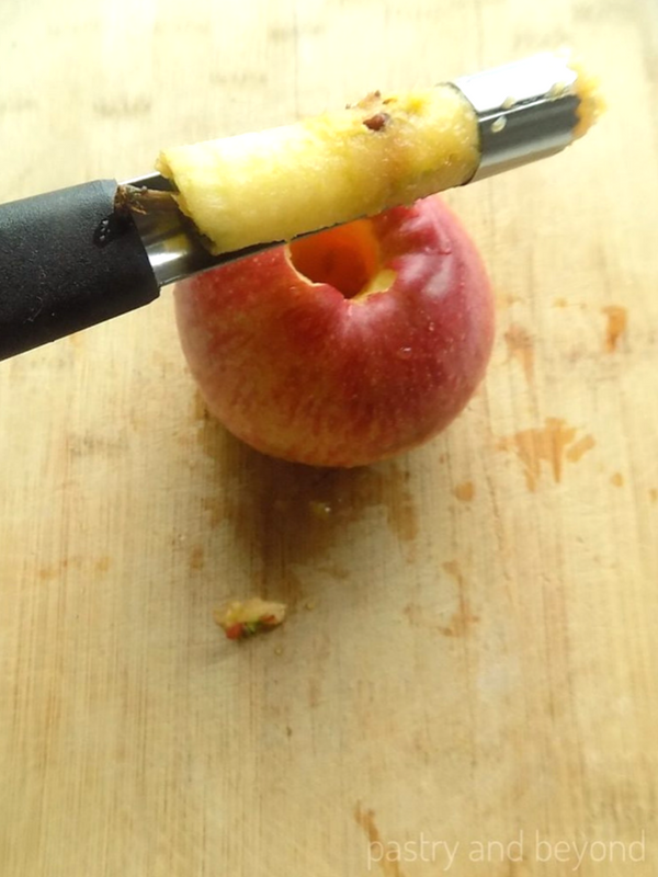 Coring apples with an apple corer.