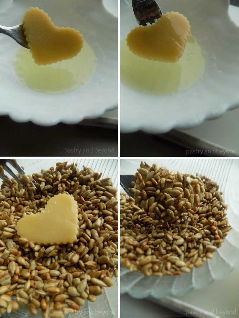 Steps of making Heart Shaped Sunflower Seed Cookies: Covering the heart cut cookie dough with egg white and sunflower seeds.