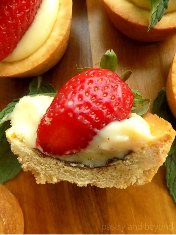 Strawberry Mint Cookie Cups with Pastry Cream cut in half.