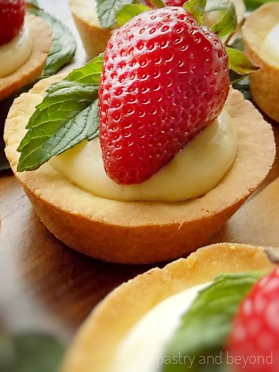 Strawberry Cookies Cups on a wooden surface.