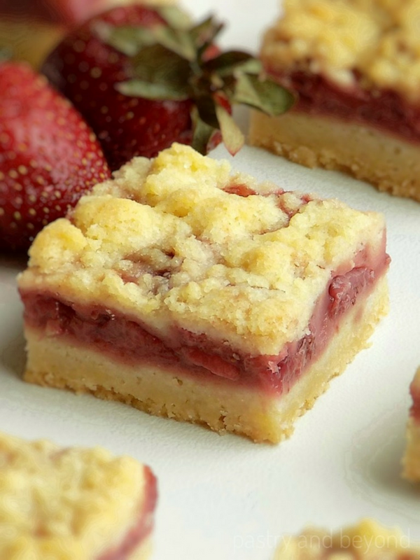 Strawberry Bars on a white surface.