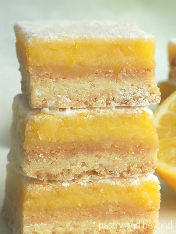 Lemon bars with lemon curd stacked on each other