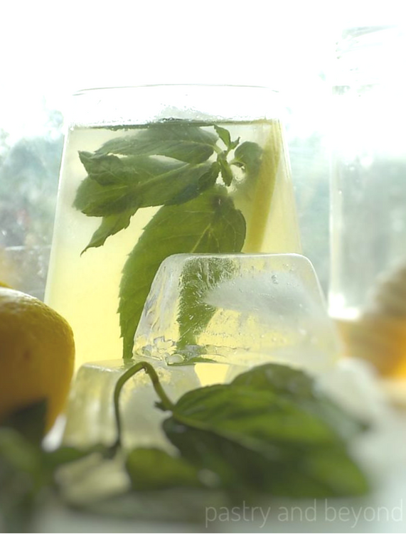 Honey Lemonade with mint and lemon slice in a glass.