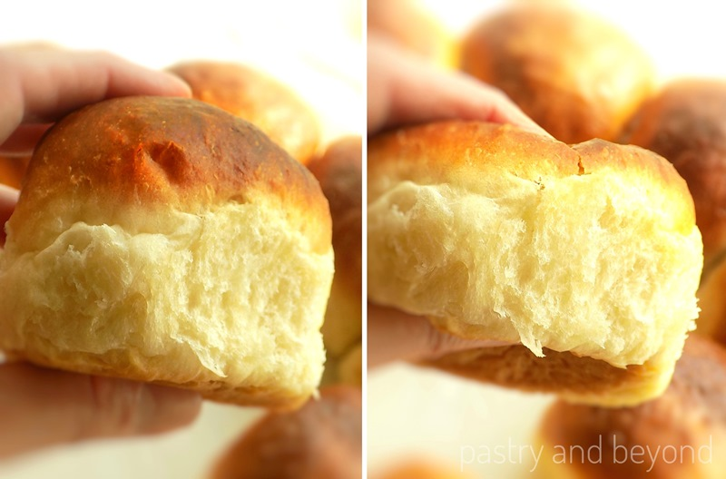 Soft Dinner Roll is hand squeezed to show is fluffiness.